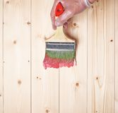 Process of starting to paint wooden boards Stock Photography
