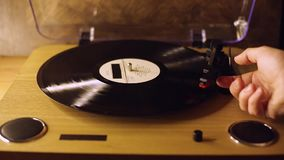 The process of starting the vinyl record from start to finish. The concept of music. Vintage player. Cinemagraph loop vinyl turntable stock video footage