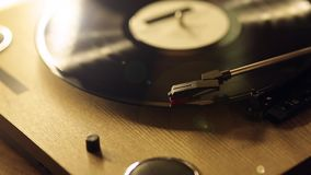 The process of starting the vinyl record thith flare. the concept of music. Vintage player. The process of starting the vinyl record from start to finish. The stock footage