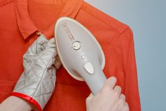 Process of steaming a shirt, close-up.  stock images