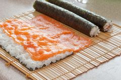 The process of sushi making at kitchen. Royalty Free Stock Photo