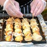 Process to Cooking Takoyaki on hot pan Famous food Osaka Japan street food Royalty Free Stock Photos