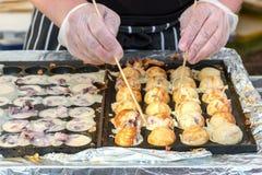Process to Cooking Takoyaki on hot pan Famous food Osaka Japan street food Stock Photos