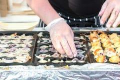 Process to Cooking Takoyaki on hot pan Famous food Osaka Japan street food Royalty Free Stock Photo