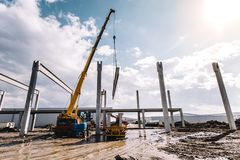Process of unloading cargo using crane, industrial cement cast p royalty free stock images