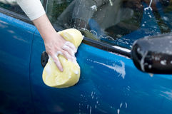 The process of washing a car with the help of shampoo and yellow Stock Images