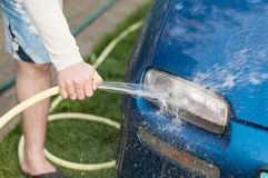 The process of washing cars headlights Royalty Free Stock Image