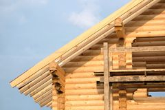 Process of wooden house straight roof slope mounting Royalty Free Stock Photography