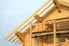 Process of wooden house straight roof slope mounting Royalty Free Stock Photo