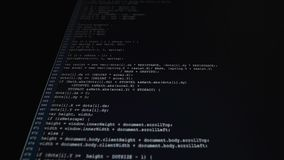 The process of writing a computer program on a computer monitor. Text is entered and quickly moved up. A large number of stock footage