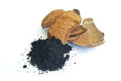 Charcoal from coconut shell. Processed coconut shell sticks.Charcoal from coconut shell royalty free stock image