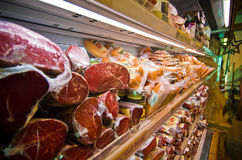 Processed meat in supermarket. Shelves with processed meat in supermarket Stock Photography