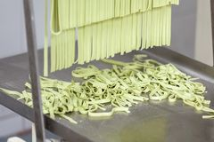 Processed Spaghetti Pasta On Machine Tray Royalty Free Stock Image