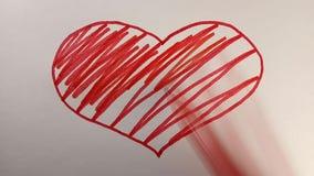 Processen av att dra en symbolisk röd hjärta, pojke och flicka