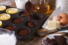 Processes of preparation of chocolate muffins close-up Royalty Free Stock Photos