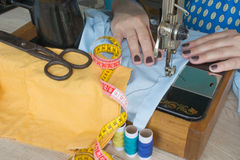 Processes of sewing on the sewing machine sew women`s hands sewing machine Stock Images