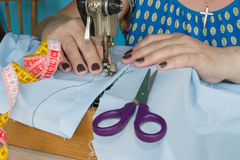 Processes of sewing on the sewing machine sew women`s hands sewing machine Stock Photography