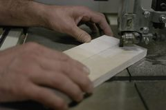 Work with Board and batten on the milling machine. Processing boards on a milling machine stock photo