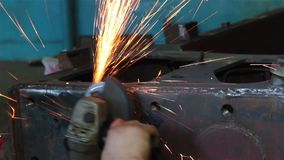 Processing of metal grinder with sparks stock video footage