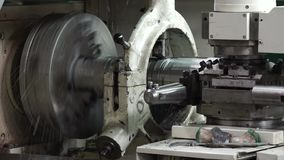 Processing of metal on the lathe. Machine tool in a workshop