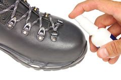 Processing trekking shoe with a protective spray Stock Images