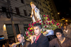 Procession Catholic. Sao Paulo, Brazil, July 20, 2014. Procession of the traditional feast dedicated to Our Lady of Carmo, at night in the Bela Vista Stock Photo