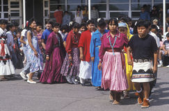 Procession of costumed Navajo schoolchildren Stock Photo