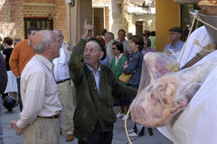 Procession with faithful old man with bags of meat royalty free stock photography