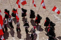 Procession of flag carriers at local festival Royalty Free Stock Photography