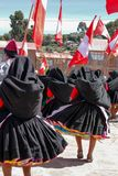 Procession of flag carriers at local festival Royalty Free Stock Images