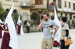 Procession of Holy Week in Galicia (Spain) and a dog Royalty Free Stock Photos