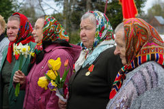 The procession and laying of wreaths at the memorial to fallen soldiers in the Kaluga region of Russia. Stock Photos