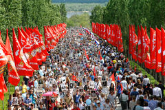 Procession of local people with photos of their relatives in Immortal Regiment on annual Victory Day on Mamaev Hill in Volgograd. Volgograd, Russia - May 9, 2016 Royalty Free Stock Photo