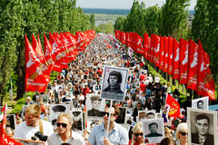 Procession of local people with photos of their relatives in Immortal Regiment on annual Victory Day on Mamaev Hill in Volgograd. Volgograd, Russia - May 9, 2016 Stock Photography