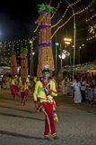 A Procession of the Natha Devala performer at the Kataragama Festival in Sri Lanka. The dancers in this procession are always dressed in yellow clothing and Royalty Free Stock Images