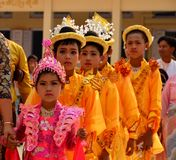 Procession of novice children in temple (begin monk life). Bagan, Myanmar - March 14, 2015: Procession of novice children in temple (begin monk life royalty free stock images