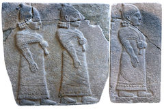 Procession of palace officials - ancient stone bas-relief. Of late Hittite period (9th Cent. B.C.) from Samal (Sinjerli) in the Istanbul Archaeology Museum in Stock Images