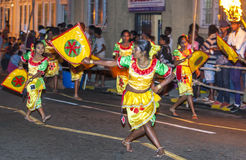 Procession of the Paththii Devala dancers move through the streets of Kandy in Sri Lanka during the Esala Perahera. Royalty Free Stock Image