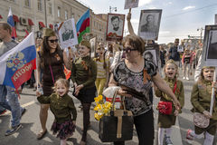 Procession of the public movement Immortal regiment. In memory of the 26 million compatriots who died in the Great Patriotic War, children shout Hurrah Royalty Free Stock Photos
