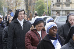 Procession with the relic of Saint Pope John Paul II. BUCHAREST, ROMANIA - OCTOBER 23, 2016: Catholic nuns are praying during the Eucharistic procession with the Royalty Free Stock Images