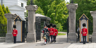 Procession at Rideau Hall Changing of the Guards. Procession of guards marching during the changing of the Guards ceremony held each hour at Rideau Hall in stock images