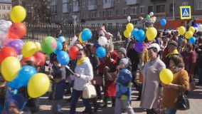 Procession on the square Procession of people with balls and flags-Russia Berezniki may 1, 2018.  stock video