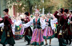 Procession of students of the Institute of culture, dancers in Cossack traditional dress, colored skirt, green trousers and maroon royalty free stock photography