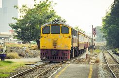 Train led by Diesel Electric old locomotives of Thailand. Procession Train led by Diesel Electric old locomotives yellow at Railroad junction Before entering Stock Photography