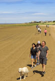 A Procession of Walkers Between West Kirby and Hoylake Royalty Free Stock Photo