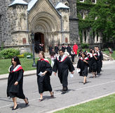 Processione di graduazione dell'università Immagine Stock