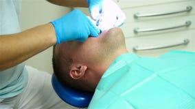 Processo dental da impressão filme