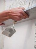 Processo di intonacare le pareti Immagine Stock