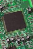 Processor. Computer processor on green board, photo Stock Photo