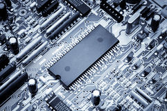 Processor board. Macro photo. Blue toned Stock Photos
